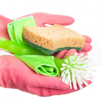 Hand in a pink glove holding sponge