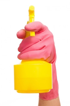 Hand in a pink glove holding spray bottle