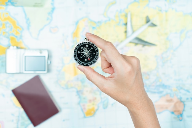 Hand to planning vacation trip and accessories for travel