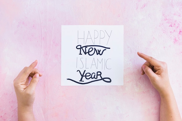 Hand pointing at islamic new year greeting