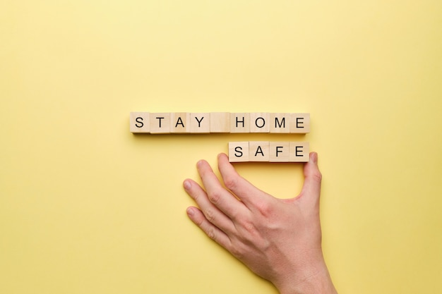 The hand points to the concept of staying home and safe.