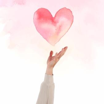Mano che presenta il cuore per l'illustrazione dell'acquerello di celebrazione di san valentino