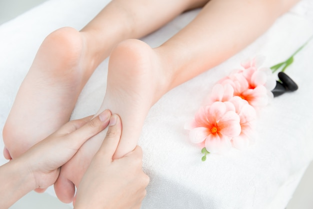 Hand press at foot massage and spa concept white clean relax healthy