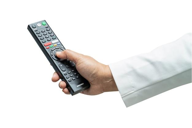 Рука нажимает телевизор дистанционного управления телевизором.