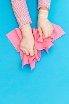 Hand protective pink glove rag wiper white background blue