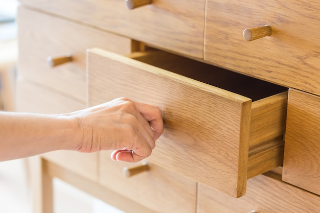 Hand pull open drawer.