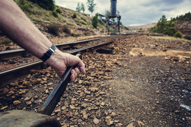 Hand pulling the lever to change the way in the old train station of zaranda