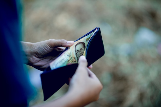 Hand and purse images of financial businessmen successful financial concept