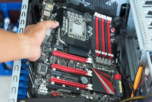 Hand put mainboard with cpu into atx computer case with cable