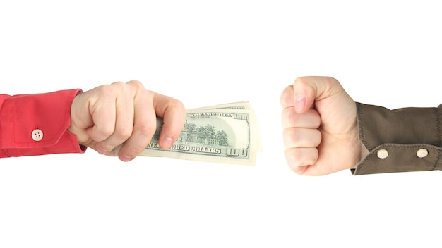 The hand reaches for the hand with the money. payment for work. business and pay. business relations. wealth and poverty
