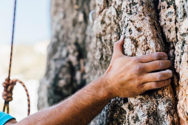 Hand of rock climber