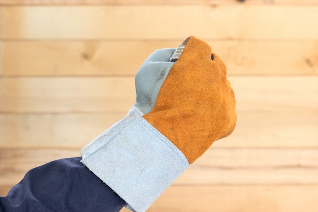 Hand in rough leather glove