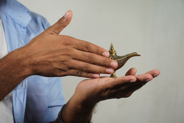 Hand rubbing lamp jinee lamp magical lamp