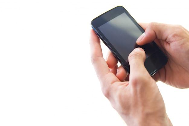 Samrtphoneを使用しているビジネスマンの手の詳細