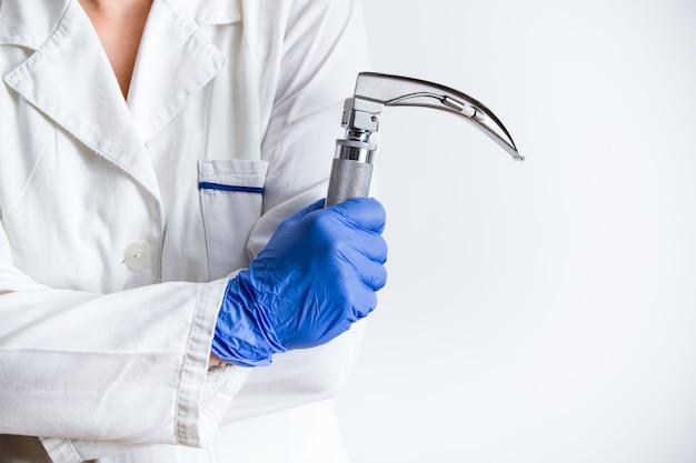 Hand's doctor holding laryngoscope
