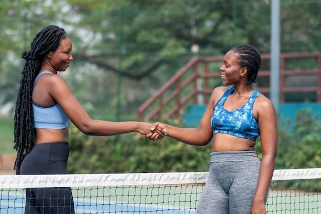 Hand shake between tennis players