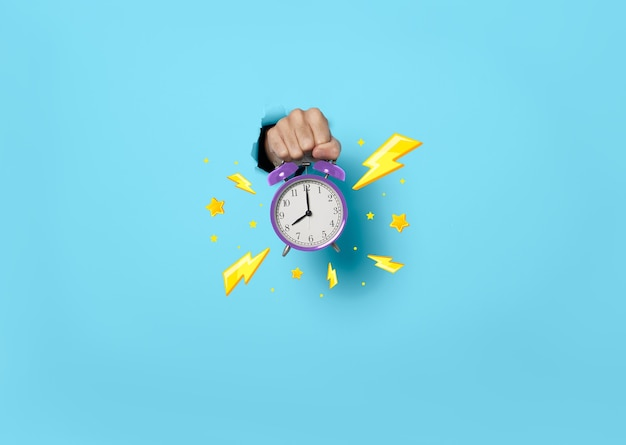 Hand showing alarm clock hour sale on blue background. deadline, time to promotion sale concept.