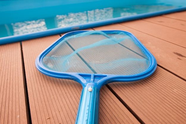 Hand sieves  net for grime  disrt by the pool