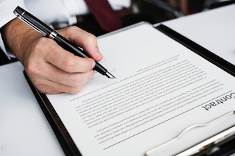 Hand signing business contract