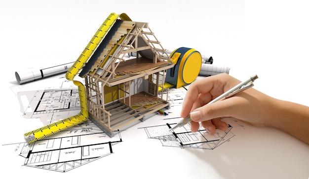 Рисование руки над архитектурным проектом