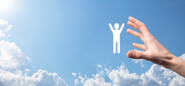 Hand on sky background holds human icon