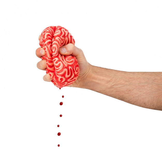 Hand squeezes a rubber brain