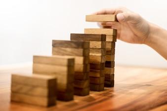 Hand stacking wooden blocks