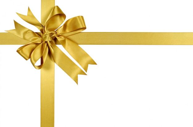 Ручная привязанная лента подарка и лук в желтом золоте