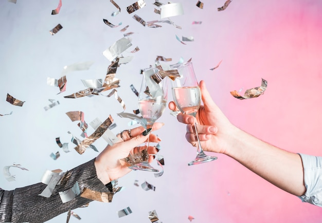 Hand toasting with confetti