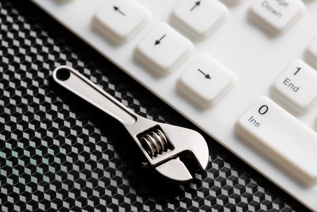 Hand tool on an white keyboard
