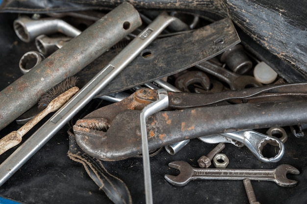 Hand tools with old rust wrench, bolts, keys