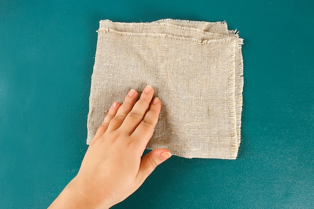 Hand touches the fabric. the concept touch, tactility, feelings.