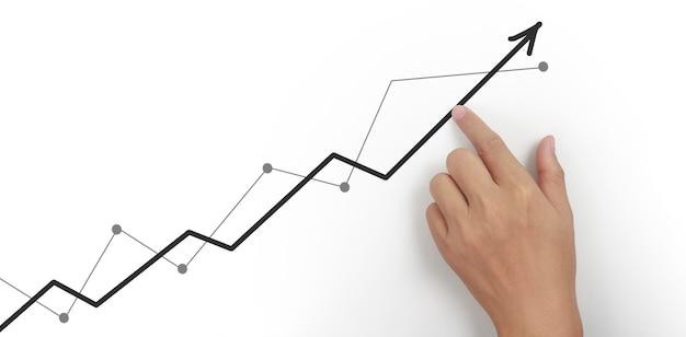 Рука касаясь графиков финансового индикатора и диаграммы анализа рыночной экономики бухгалтерского учета