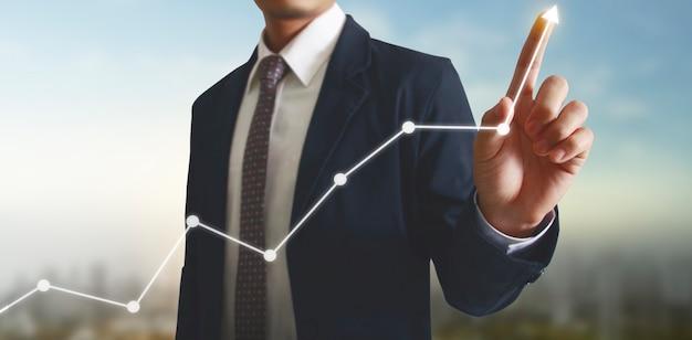 財務指標と会計市場経済分析グラフのグラフに触れる手
