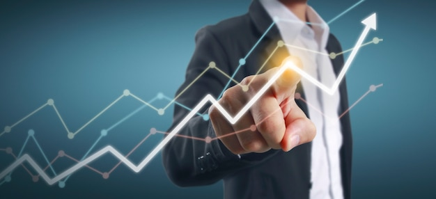 Hand touching  graphs of financial indicator and accounting market economy analysis chart
