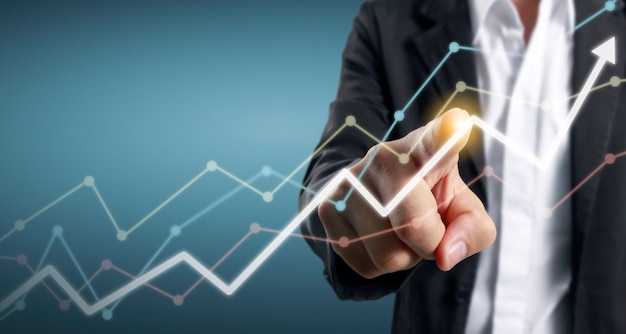 Hand touching graphs of financial indicator accounting market economy analysis chart