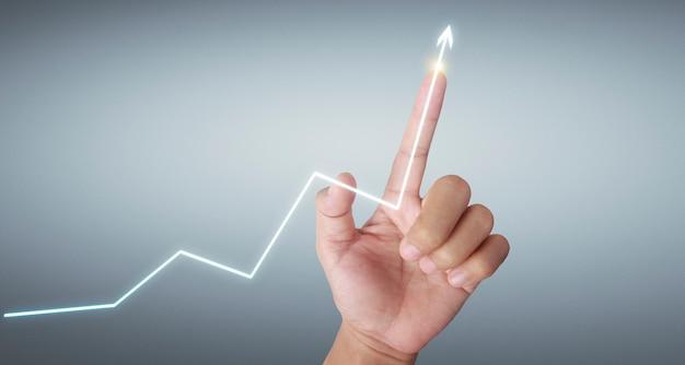 財務指標と会計市場チャートの手で触れるグラフ
