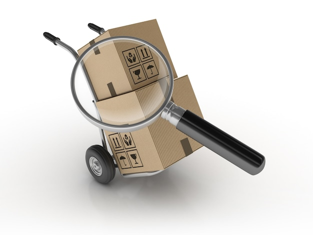Hand truck and cardboard boxes with magnifiying glass