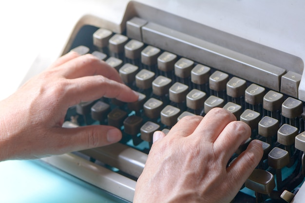 Hand on type old style typewriter