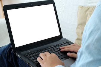 Hand typing laptop with blank screen background