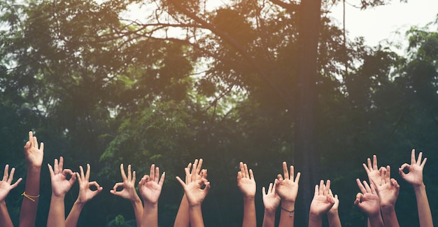Hand up of people working assemble corporate meeting show symbol join forces teamwork
