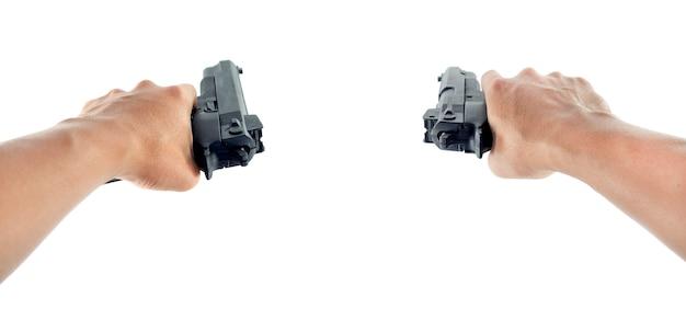 Hand using a hand gun pistol