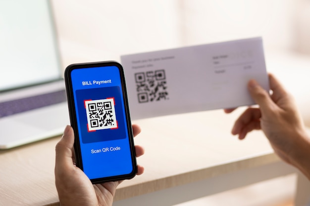 Hand using a smartphone to scan a qr code
