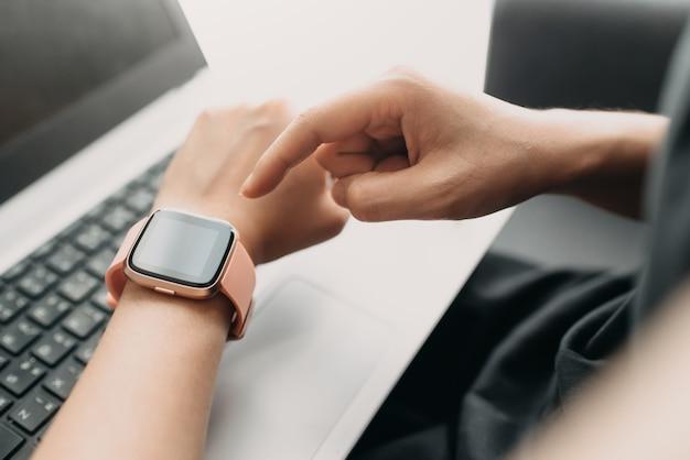 Hand using a smartwatch