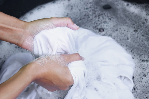 Hand washing dirty white shirt for cleaning