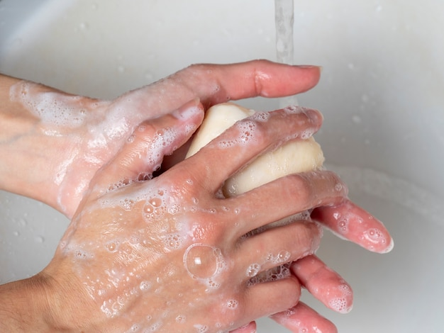 Hand washing with soap. concept of personal hygiene, countering viruses and microbes