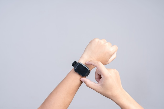 Hand wearing modern smart watch