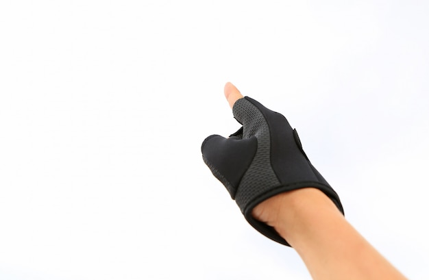 Hand wearing sport glove pointing up isolated on white background