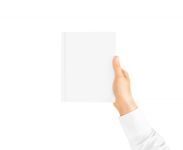 Hand in white shirt holding closed blank book
