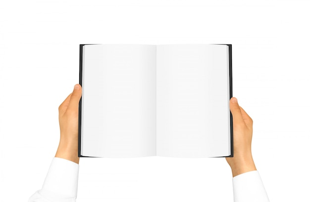 Hand in white shirt sleeve holding blank book